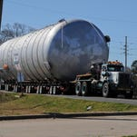 The contained burn chamber that will be used by Explosive Service International to dispose of M6 propellant and Clean Burning Igniter continues its journey through Haughton  along La. Highway 157 to Louisiana National Guard's Camp Minden, Feb. 11.