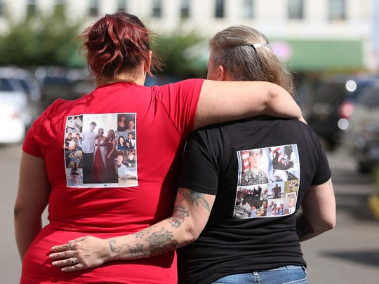 Christina Mendez-Carandia, left, and family friend Rebecca DeVoe wear t-shirts with a collage of pictures of her brother, Matthew Pearce, who was shot and killed by Nicholas Ransom in 2015. Ransom was sentenced on Tuesday, Aug. 2, 2016, at the Polk County Courthouse in Dallas. Ransom pleaded guilty to second-degree manslaughter and unlawful possession of a firearm by a felon. He was sentenced to seven years and six months in prison.