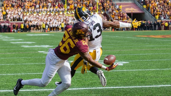 Oct 8, 2016; Minneapolis, MN, USA; Minnesota Golden Gophers wide receiver Brian Smith (26) attempts to make a catch behind Iowa Hawkeyes defensive back Greg Mabin (13) in the second half at TCF Bank Stadium. The Hawkeyes won 14-7. Mandatory Credit: Jesse Johnson-USA TODAY Sports
