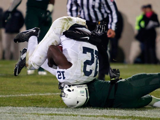 Penn State receiver Chris Godwin (12) scores a touchdown against Michigan State's Darian Hicks during the fourth quarter Saturday in East Lansing, Mich. Michigan State won 55-16.