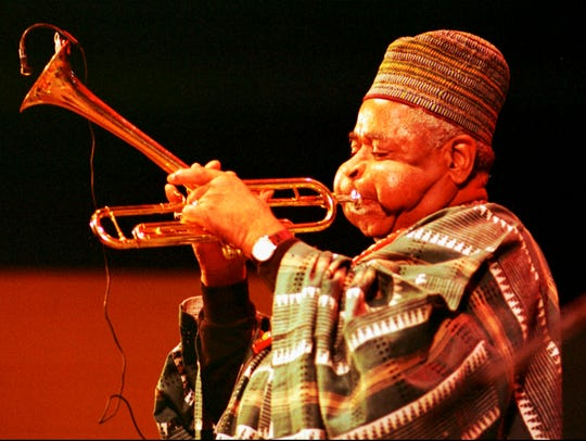Dizzy Gillespie plays his trumpet on the main stage