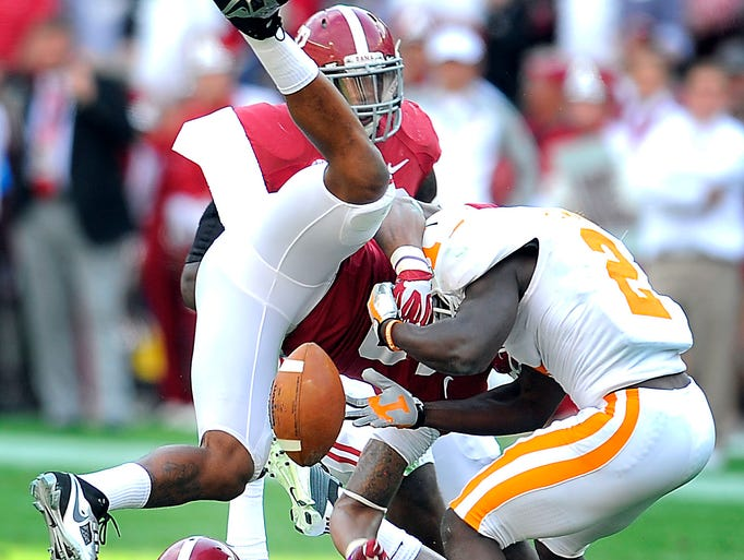 Alabama defensive back Ha Ha Clinton-Dix (6) goes upside down to interrupt a pass intended for Tennessee receiver Pig Howard (2) in a 2013 game.
