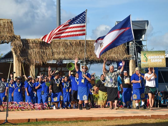 Delegates of American Samoa make their exit through center stage during the 12th Festival of Pacific Arts Guam 2016 closing ceremony at Paseo Stadium in Hagatna on June 4.