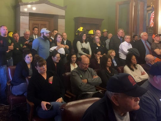 A crowd heavily composed of public employees listens at an Iowa Senate committee meeting Thursday where lawmakers advanced Senate File 213 on a 7-4 vote to rewrite the state's collective bargaining law for public employees.