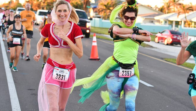 The 3rd Annual Ron Jons Cocoa Beach Half Marathon got underway at 7:00 a.m. Sunday with many runners in costume.