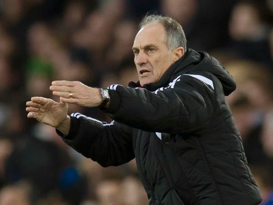 FILE - In this Sunday Jan. 24, 2016 file photo Swansea City's manager Francesco Guidolin issues instructions during the English Premier League soccer match between Everton and Swansea at Goodison Park Stadium, Liverpool, England. Bob Bradley has become the first American manager of a Premier League club after being hired by Swansea City while announcing on Monday Oct. 3, 2016 it had fired Francesco Guidolin. (AP Photo/Jon Super, File)