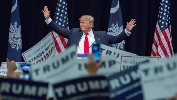Donald Trump waves to supporters at a rally in Myrtle