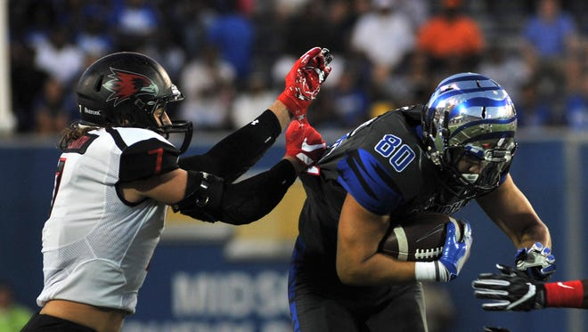 Sep 3, 2016; Memphis, TN, USA; Memphis Tigers tight end Daniel Montiel (80) carries the ball against Southeast Missouri State Redhawks linebacker Chad Meredith (7) and cornerback Ryan Moore (24) during the first half at Liberty Bowl Memorial Stadium. Mandatory Credit: Justin Ford-USA TODAY Sports