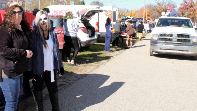 Megan Osmun and Rebecca Bakker pass out treats for Justin Scott State Farm at the fairgrounds Saturday.