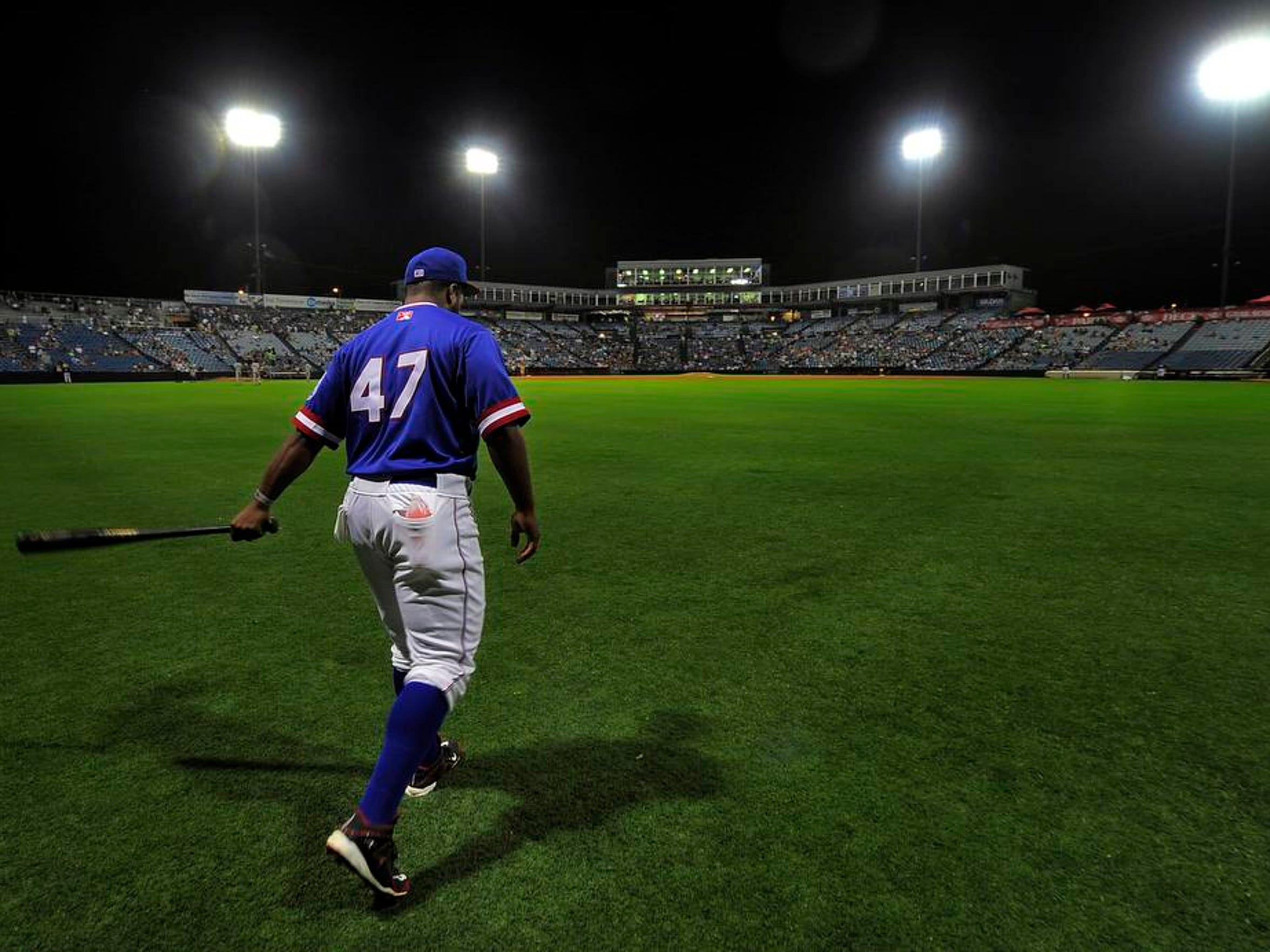 Sounds third baseman Jason Rogers makes his way across the field before the start of their second game of a double header against the Fresno Grizzlies at Greer Stadium Thursday Aug. 21, 2014, in Nashville, Tenn.