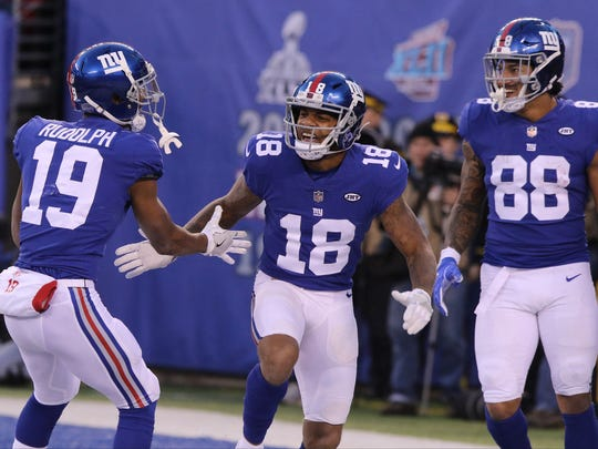 Giants WR Roger Lewis Jr. celebrates with Travis Rudolph and Evan Engram after his 34-yard catch in overtime on Sunday.