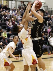 Jason Rodriguez of Corning goes up for a shot as Jordanny