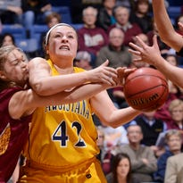 Northern State's Devon Brecke tries to knock the ball away from Augustana's Naomi Rust on Feb. 6 at the Arena, in a game the Vikings won on a last-second put-back basket. Northern and Augie tangle again today at noon at the Pentagon in the NSIC tourney.