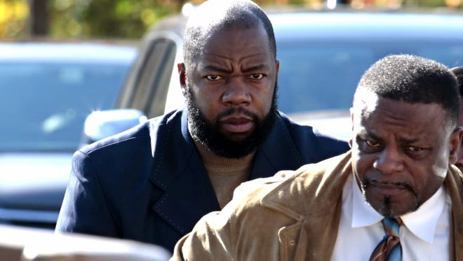 Tyrone Mushatt, left, former Westchester Community College men's basketball coach, arrives at Mount Pleasant Town Court for arraignment on Oct. 29, 2015.  He was accused of using bogus transcripts to help star players earn NCAA Division I scholarships.