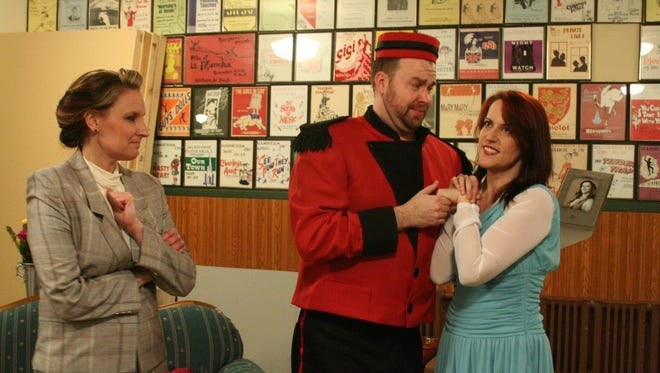 Corrie Skubal (from left) as Murphy Stevens, assistant to Athena Sinclair; Patrick Schamburek as Francis, the bellhop; and Susan Nechodomu as Athena Sinclair, entertainer. Murphy isn't sure what to make of Athena in a bellhop's arms.