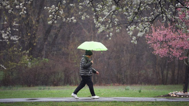 After a devastating thunderstorm ripped through the area Tuesday, residents can expect less severe rainfall through the weekend.