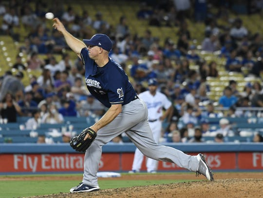 Catcher Erik Kratz pitches a 1-2-3 ninth inning to mercifully end the Brewers' nightmare of a game against the Dodgers.