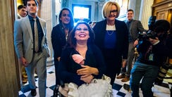 Democratic Senator from Illinois Tammy Duckworth carries