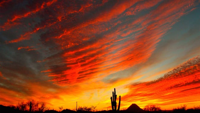 A colorful sunset spreads above the desert in New River.