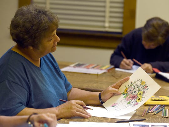 Ruby Eikermann of Robards examines her coloring work