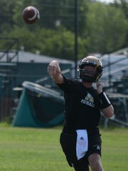 Andrew Ezzell throws a pass during the Eagles' first