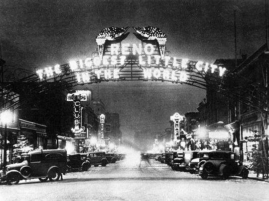 This one of the best-known photographs of the original Reno Arch from 1929 after the motto was changed.