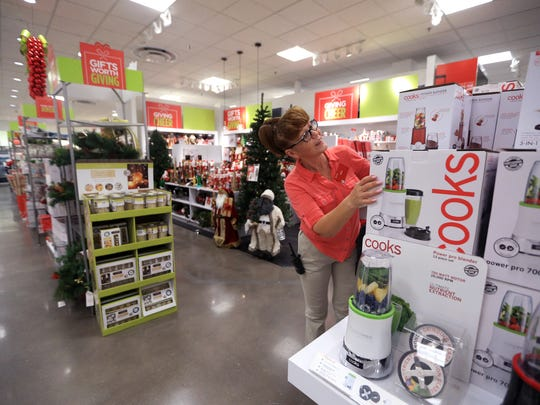Irina Cox, an operations associate at JCPenney, stocks small appliances on Tuesday, Nov. 22, 2016, for upcoming holiday sales at the store in La Palmera mall. The store opens at 3 p.m. Thanksgiving day. These appliances will be  offered at deep discounts when the store opens.