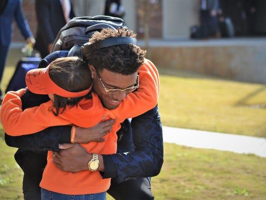 Clemson quarterback Kelly Bryant hugs Savana Jones,