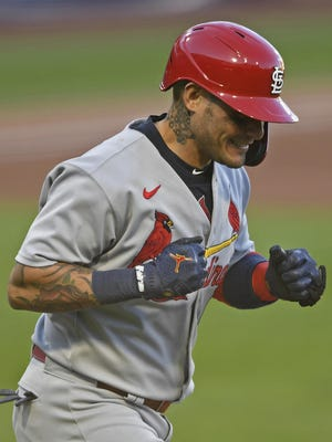 Cardinals' Yadier Molina celebrates a home run on Sunday in Pittsburgh.