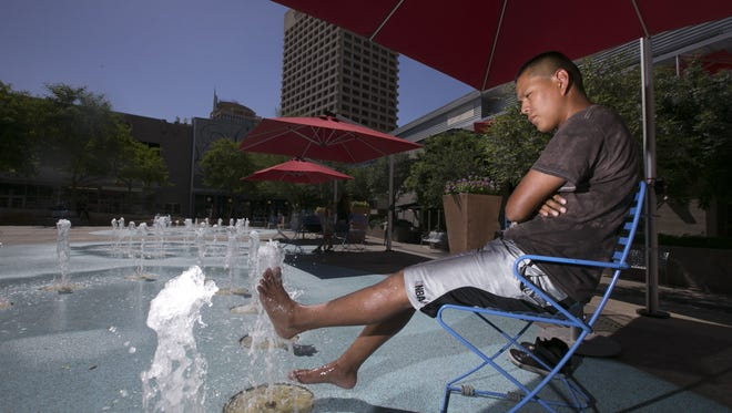 in the splash pad at CityScape in downtown Phoenix on Thursday, June 16, 2016. Temperatures are expected to be 117 degrees in Phoenix on Sunday and Monday according to the National Weather Service.