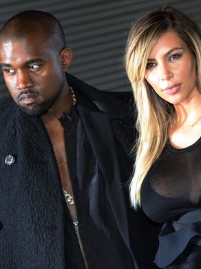 The two strike a pose before the Givenchy 2014 Spring/Summer ready-to-wear collection fashion show, in September 2013 in Paris. Thanks to West, Kardashian became much more immersed in the fashion worlds of Paris and Milan.
