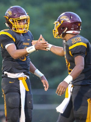 Cooper's Dante Hendrix and Jaden Jackson celebrate Jackson's second-quarter touchdown during their game with NewCath at Cooper Friday, August 26, 2016.
