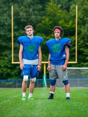 Bailey Olson, left, and Brayden Duggan have both faced down health challenges to play football for Colchester High School. Seen on Tuesday, August 28, 2017.