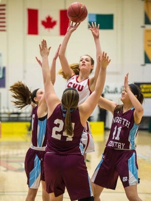 Champlain Valley Union's Shannon Loiseau, center, shoots over North Country Union defenders in Burlington on Wednesday, March 7, 2018.