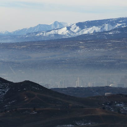 An inversion is seen over the Truckee Meadows from the Golden Valley area north of Reno on Feb. 12, 2016.