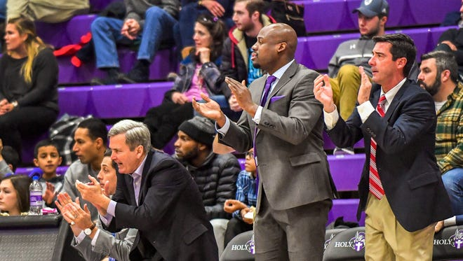 Milwaukee Washington standout and University of Wisconsin alumnus Freddie Owens (center) is currently an assistant coach at Holy Cross.
