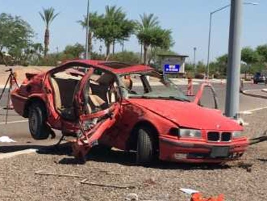 totaled red sedan ejects teens