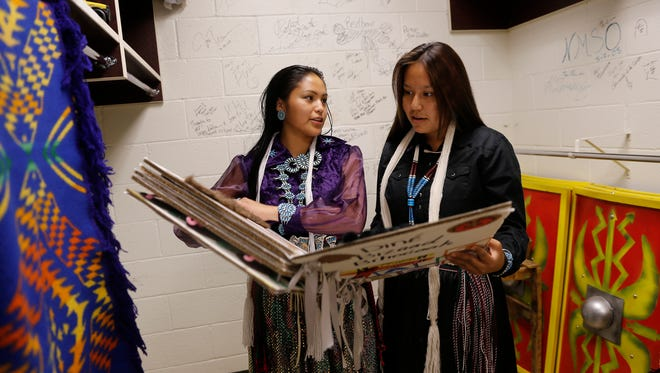 From left, Miss Northern Navajo Teen competition contestants Ariana Young and Tisharae Nelson look at the book Young used during the talent portion of the pageant on Thursday at the Phil L. Thomas Performing Arts Center in Shiprock. The pageant was among the highlights of the first day of the Northern Navajo Nation Fair. The annual fair kicked off on Thursday and runs through Sunday at the fairgrounds in Shiprock. For more information, go to nnnfair.org.