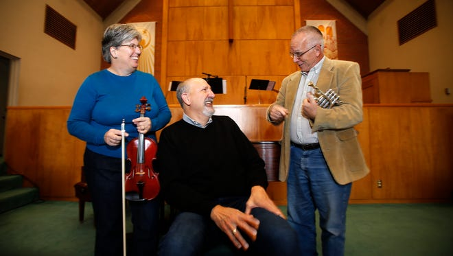 Cathy Pope, left, the Rev. Glenn Perica and Mick Hesse talk on Oct. 30 about the new 'Showcase on Dustin' concert series at First Presbyterian Church in Farmington.
