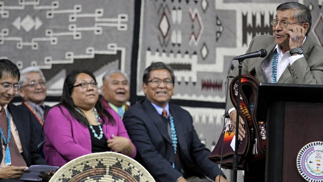 At right, former Navajo Nation President Ben Shelly speaks on May 12 during the inauguration ceremony for President Russell Begaye, second from right, at the Fighting Scouts Events Center in Fort Defiance, Ariz.