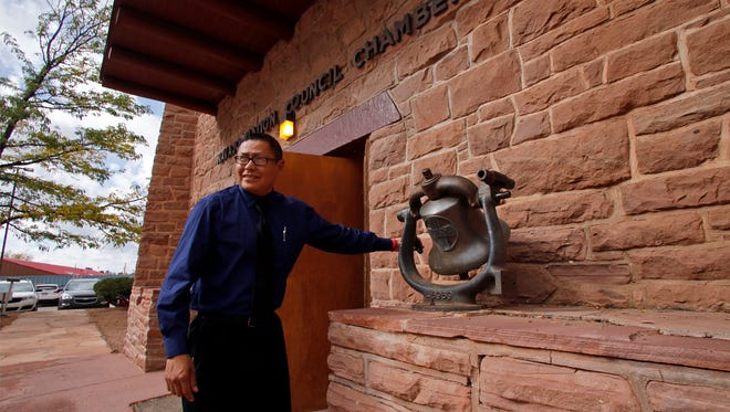 Seymour Smith rings the bell Oct. 19 signaling the start of the fall session of the Navajo Nation Council at the council chambers in Window Rock, Ariz.  The council's summer session begins Monday.