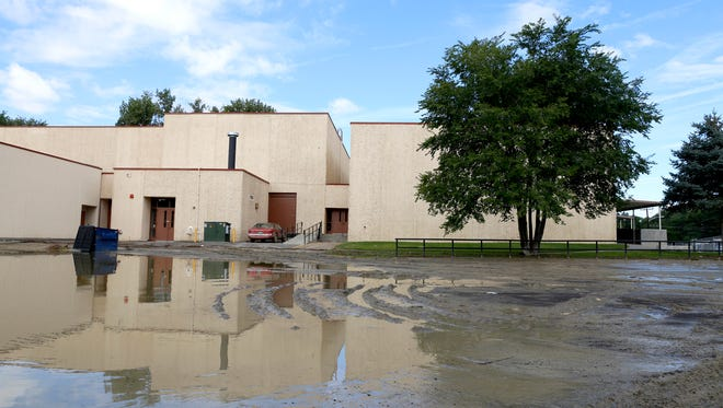 A flooded parking lot at Aztec High School is pictured Aug. 27 after a storm.
