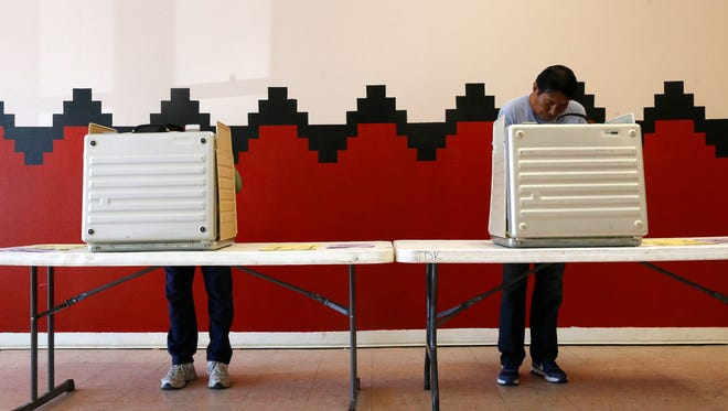 Voters fill out their ballots in the Navajo Nation primary election on Aug. 30 at the Hogback Chapter house.