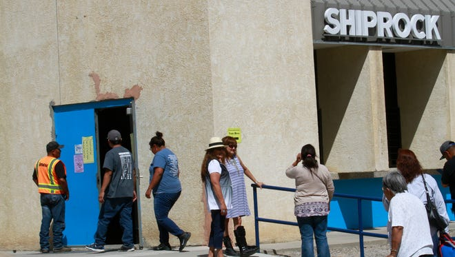 Voters line up on Aug. 30 to vote in the Navajo Nation primary elections at the Shiprock Chapter House.
