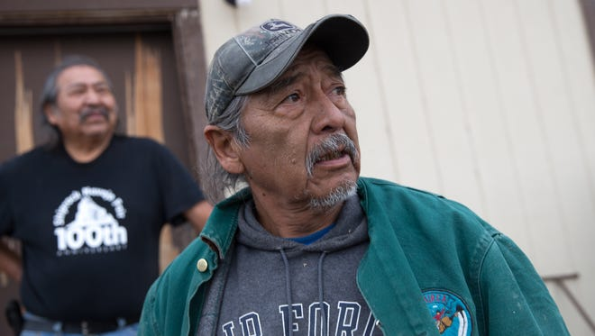 At right, Joe Ben Jr., a former Shiprock Chapter Farm Board member who served during the Gold King Mine spill, talks on Friday about his dissatisfaction with the U.S. Environmental Protection Agency after it announced it will not pay claims filed against it in response to the spill. Ben speaks at the farm of Earl Yazzie, pictured at left, in Shiprock.