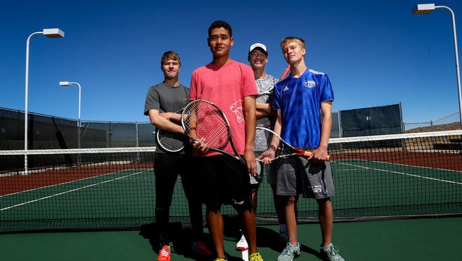 From left, Riley Hill, Kyler Edwards, Kaden Weisheit and Spencer Hill pose for a portrait on Friday at the Farmington Tennis Complex.