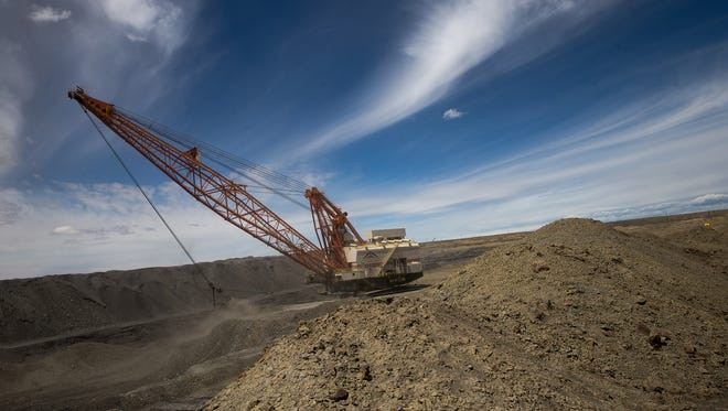 A drag line operates Wednesday at the Dixon Pit area of the Navajo Mine in Nenahnezad..