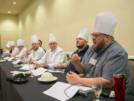 Owner of Crust & Craft, Brenton Wallace, join other culinary judges as they talk to students from Lake Forest on their dishes.