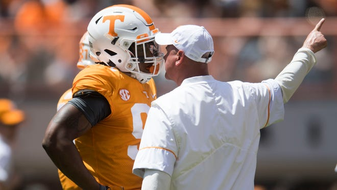 Tennessee Head Coach Jeremy Pruitt speaks to Tennessee running back Tim Jordan (9) before the Tennessee Orange & White spring game at Neyland Stadium at University of Tennessee Saturday, April 21, 2018.