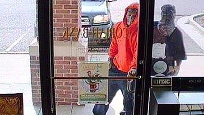 Surveillance of bank robbery suspects in Clinton, Miss.